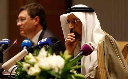 FILE PHOTO: Saudi Energy Minister Khalid al-Falih and Russian Energy Minister Alexander Novak attend a news conference at the Ritz-Carlton hotel in Riyadh, Saudi Arabia February 14, 2018. REUTERS/Faisal Al Nasser/File Photo