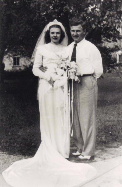 In this Aug. 20, 1947 photo, Harold and Ruth Knapke pose for a photo on their wedding day in St. Henry, Ohio. Relatives of the Ohio couple, who died at a nursing home 11 hours apart on the same day, said their love story's ending reflects their devotion over 65 years of marriage. The Knapke's died in their shared room on Aug. 11, days before their 66th anniversary. (AP Photo/Knapke Family)