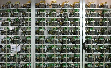 FILE PHOTO: Cryptocurrency miners are seen on racks at the HydroMiner cryptocurrency farming operation near Waidhofen an der Ybbs