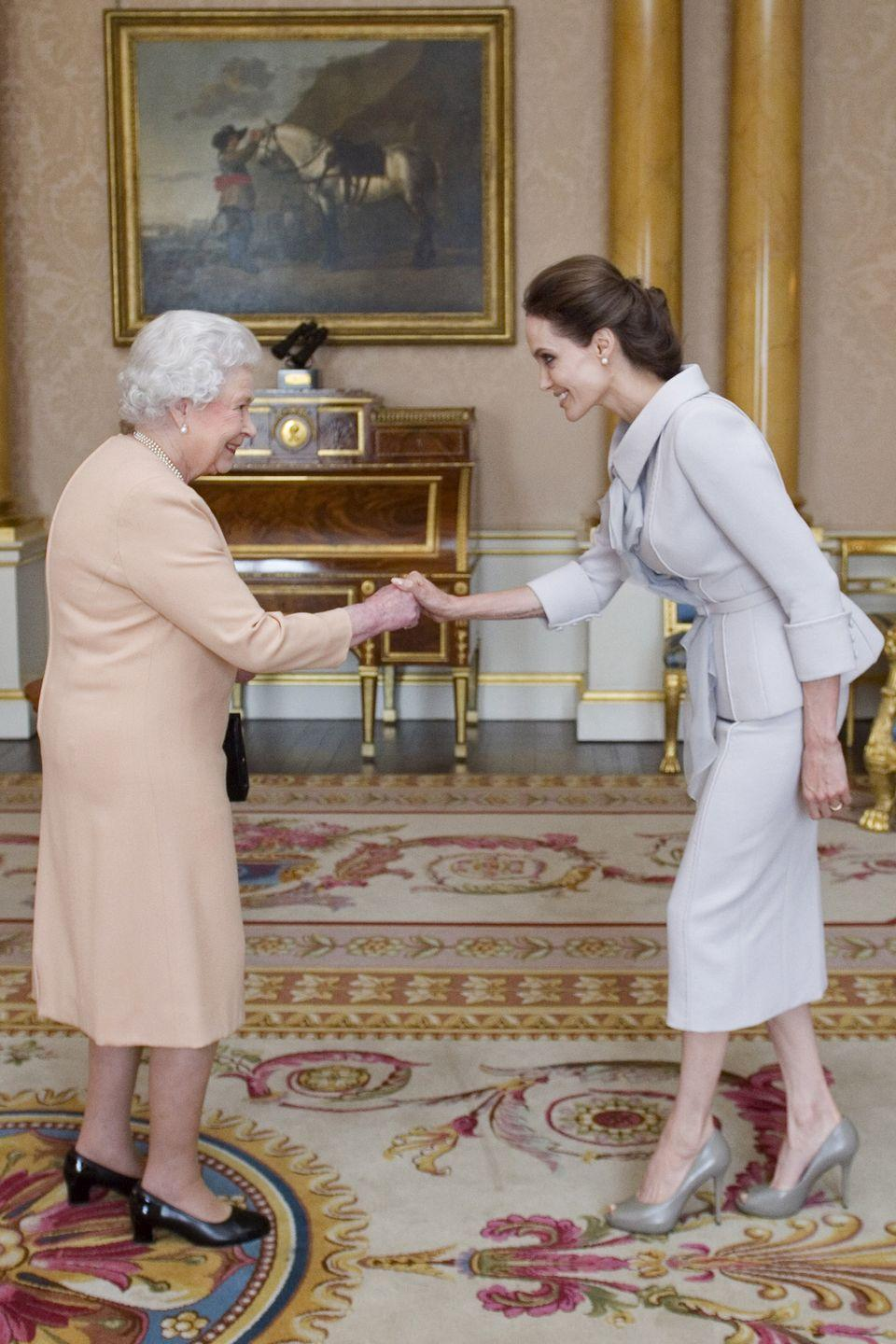 <p>Queen Elizabeth II presented Angelina Jolie with the Insignia of an Honorary Dame Grand Cross of the Most Distinguished Order of Saint Michael and Saint George in honor of her philanthropic commitments. </p>