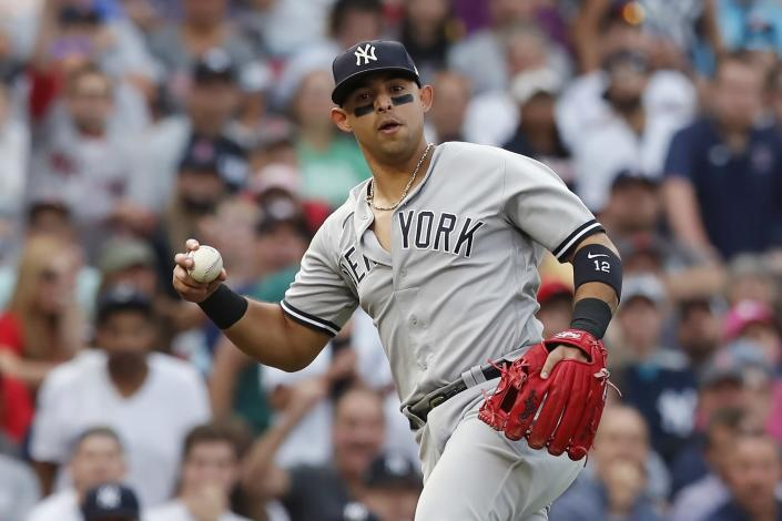New York Yankees' Rougned Odor holds onto the ball on the infield single by Boston Red Sox's Jose Iglesias to load the base during the fifth inning of a baseball game, Saturday, Sept. 25, 2021, in Boston. (AP Photo/Michael Dwyer)