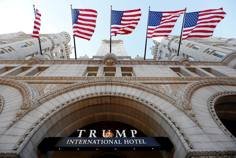 FILE PHOTO - Flags fly above the entrance to the new Trump International Hotel on its opening day in Washington, DC, U.S. on September 12, 2016. REUTERS/Kevin Lamarque/File Photo