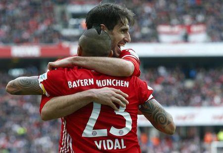 Football Soccer - FC Cologne v Bayern Munich - German Bundesliga - RheinEnergie stadium, Cologne, Germany - 04/03/17 - Bayern Munich's Javi Martinez of Spain celebrates his goal against FC Cologne with fellow team mate Arturo Vidal of Chile.        REUTERS/Ralph Orlowski