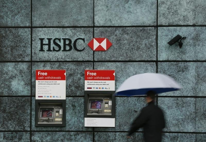 A man walks past a HSBC bank branch in the City of London