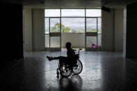 Patient Desalegn Gebreselassie, 15, uses a wheelchair to explore the Ayder Referral Hospital in Mekele, in the Tigray region of northern Ethiopia, on Thursday, May 6, 2021. His foot was injured when a grenade exploded in his town of Edaga Hamus. (AP Photo/Ben Curtis)