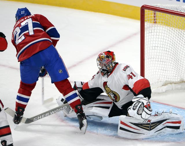 Ottawa Senators goaltender Craig Anderson stops Montreal Canadiens' Alex Galchenyuk during the second period of an NHL preseason hockey game, Thursday, Sept. 26, 2013 in Montreal. (AP Photo/The Canadian Press, Ryan Remiorz)