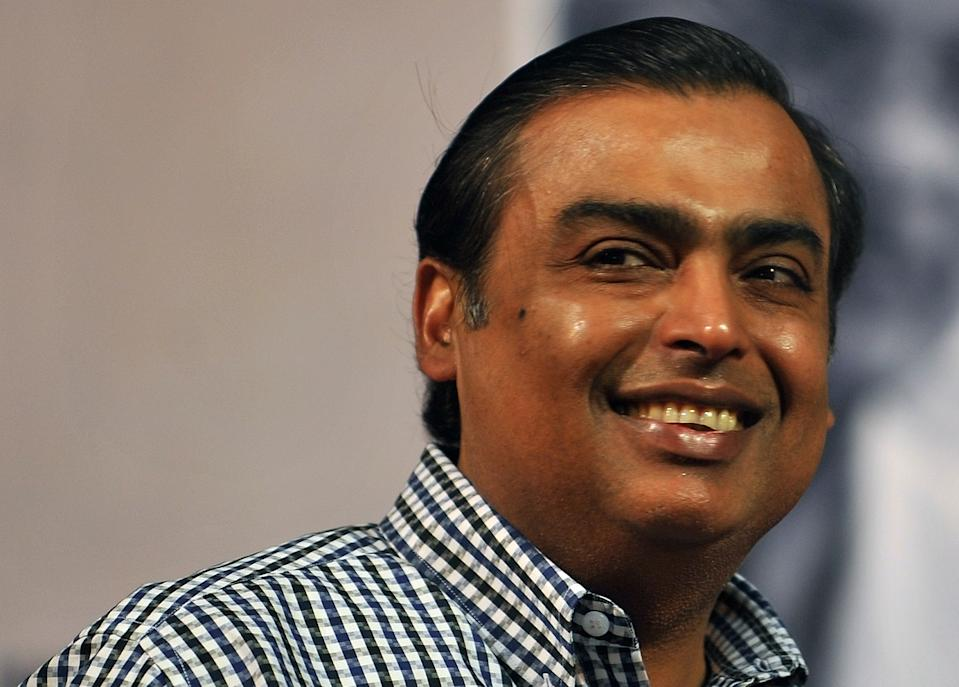 (FILES) This photo taken on June 17, 2010 of chairman of India's largest private sector firm, Reliance Industries, Mukesh Ambani at a book launch function in Mumbai. On September 30, 2010 tycoon Mukesh Ambani, retained his title as the richest Indian for a third year in 2010 with a worth of 27 billion dollars, Forbes said. India's fast-expanding economy has minted 17 new billionaires in the last 12 months, pushing the total to a record 69, according to a new Forbes Rich List released today. AFP PHOTO/ Punit PARANJPE / FILES