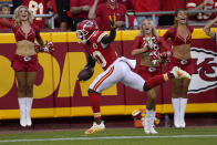 Kansas City Chiefs wide receiver Tyreek Hill scores during the first half of an NFL football game against the Minnesota Vikings Friday, Aug. 27, 2021, in Kansas City, Mo. (AP Photo/Ed Zurga)