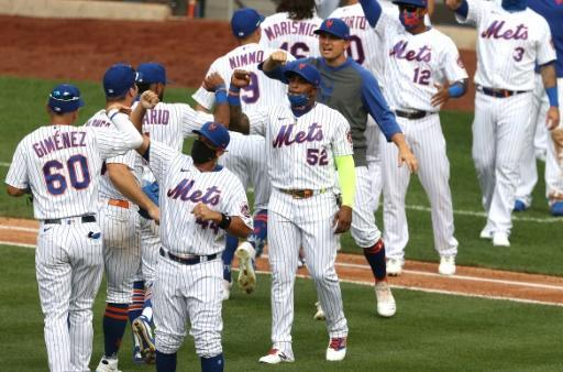 New York Mets Yoenis Cespedes, 52, celebrates a 1-0 win with his teammates against the Atlanta Braves in after their opening day game at Citi Field