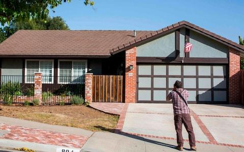 <span>A photographer takes pictures of the home of suspected nightclub shooter Ian David Long in Thousand Oaks</span> <span>Credit: AFP </span>