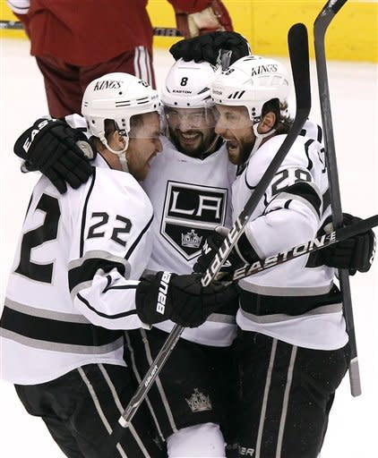Los Angeles Kings' Trevor Lewis (22), Drew Doughty (8), and Jarret Stoll (28) celebrate a goal by Dwight King against the Phoenix Coyotes in the first period during Game 2 of the NHL hockey Stanley Cup Western Conference finals, Tuesday, May 15, 2012, in Glendale, Ariz. (AP Photo/Ross D. Franklin)