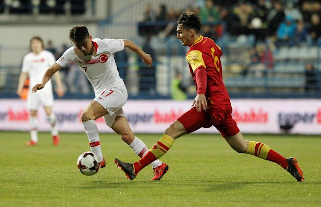 Soccer Football - International Friendly - Montenegro vs Turkey - Podgorica City Stadium, Podgorica, Montenegro - March 27, 2018 Montenegro's Zarko Tomasevic in action with Turkey's Cengiz Under REUTERS/Stevo Vasiljevic