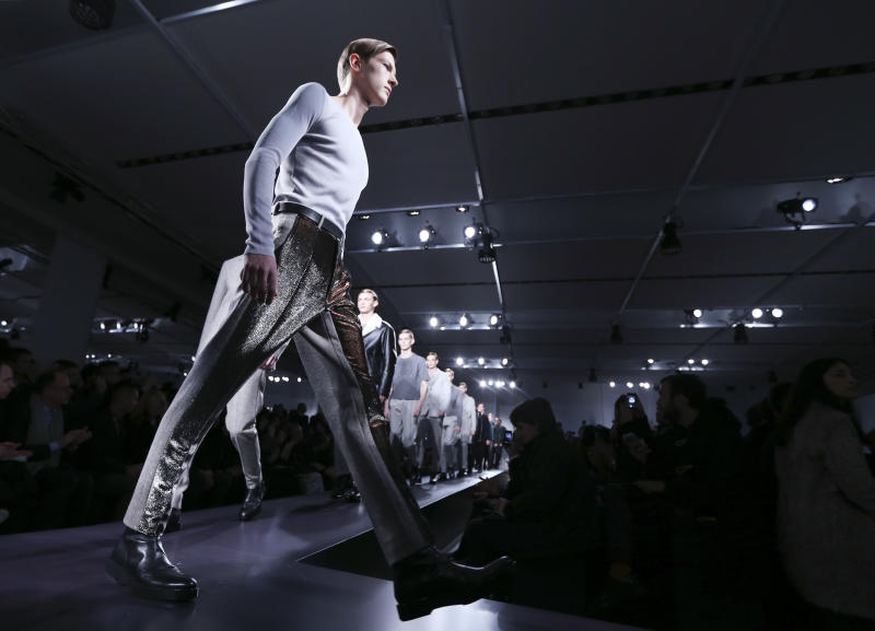 Models wear creations for Jil Sander men's Fall-Winter 2014 collection, part of the Milan Fashion Week, unveiled in Milan, Italy, Saturday, Jan.11, 2014. (AP Photo/Luca Bruno)