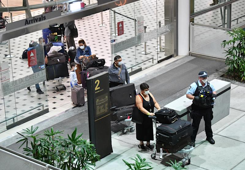 Australians evacuated from South America due to the coronavirus (COVID-19) are seen after landing at Brisbane International Airport in Brisbane, Tuesday, April 14, 2020. The Qantas flight from Lima, repatriated 115 passengers back to Australia. AAP Image