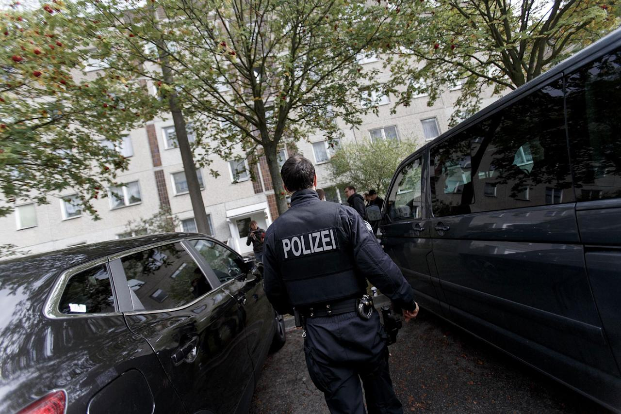 <p>German police outside of the apartment building where hours earlier police arrested Syrian terror suspect Jaber Al-Bakr on October 10, 2016 in Leipzig, Germany. Al-Bakr is accused of planning a terror attack and having prepared high explosives for it at an apartment in Chemnitz. Police raided the Chemnitz apartment on Saturday but Al-Bakr managed to flee. According to media reports he approached two fellow Syrians at the main train station in Leipzig and asked if he could stay with them. The two men reportedly brought him to their apartment but then overwhelmed him and called the police. (Carsten Koall/Getty Images) </p>