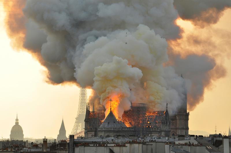 As Notre Dame burned, organist Johann Vexo and worshipers calmly filed out halfway through a reading of the Gospels.