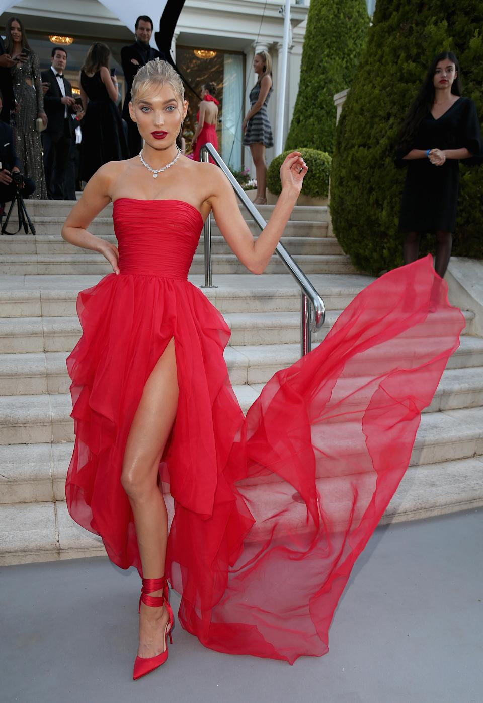 <p>Elsa Hosk opted for a striking red gown by Ermanno Scervino for the 2018 amfAR Gala during Cannes Film Festival on 17 May. <em>[Photo: Getty]</em> </p>