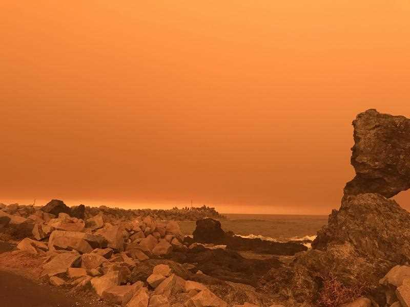 An orange hazy sky is seen over Narooma in NSW on Saturday, January 4, 2020.