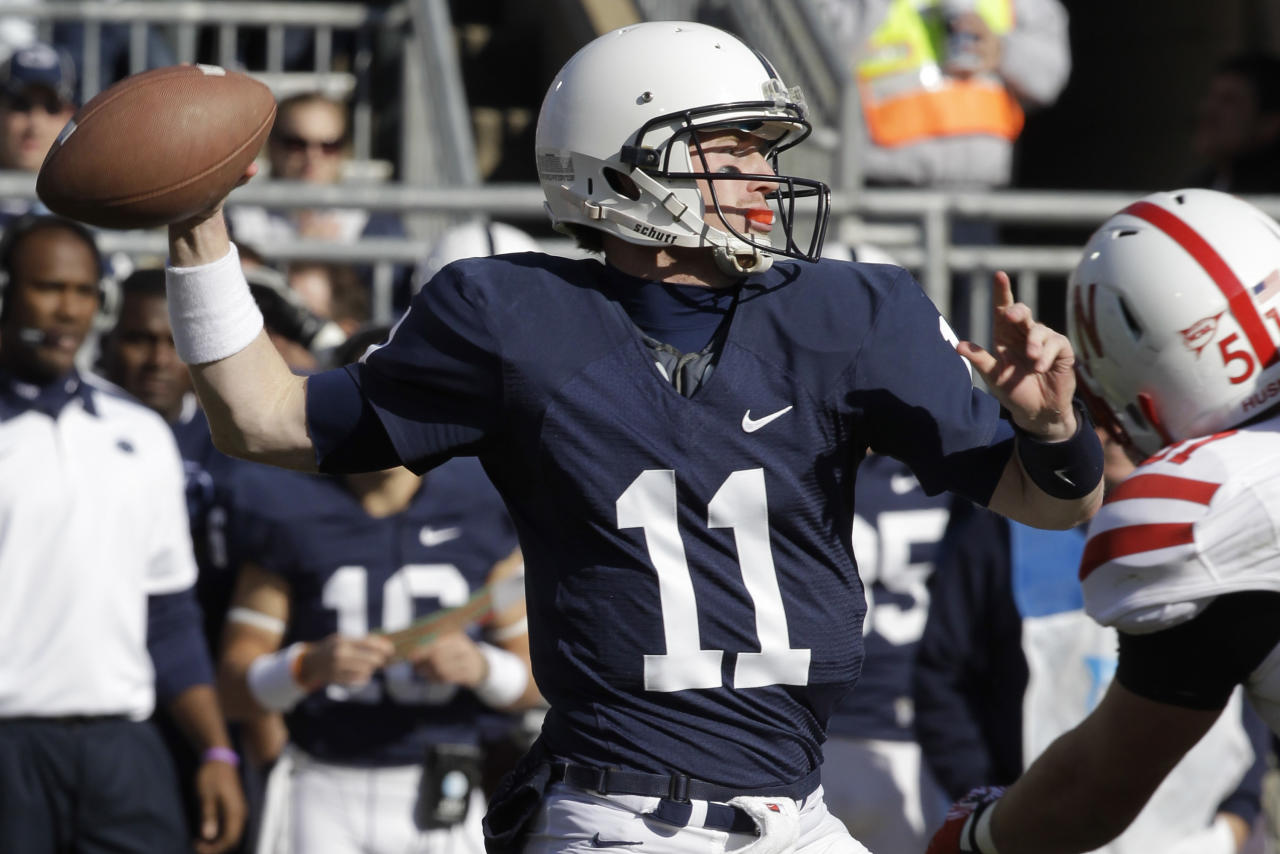 Penn State quarterback Matt McGloin (11) looks to pass during the first quarter of an NCAA college football game against Nebraska in State College, Pa., Saturday, Nov. 12, 2011. (AP Photo/Gene J. Puskar)