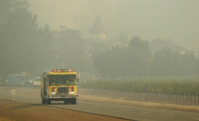 <p>A fire truck makes its way through the Chateau St. Jean winery, Tuesday, Oct. 10, 2017, in Kenwood, Calif. (Photo: Eric Risberg/AP) </p>
