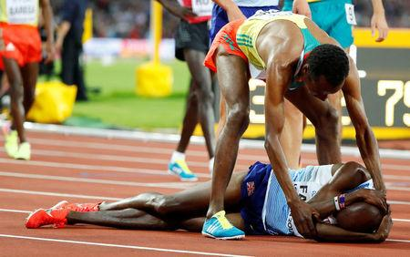 Athletics - World Athletics Championships – men's 5000 meters final – London Stadium, London, Britain – August 12, 2017 – Muktar Edris of Ethiopia comforts Mo Farah of Britain after the race. REUTERS/Lucy Nicholson