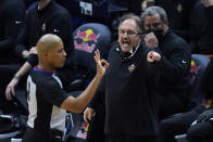 New Orleans Pelicans coach Stan Van Gundy questions referee CJ Washington during the first half of the team's NBA basketball game against the Chicago Bulls in New Orleans, Wednesday, March 3, 2021. (AP Photo/Gerald Herbert)