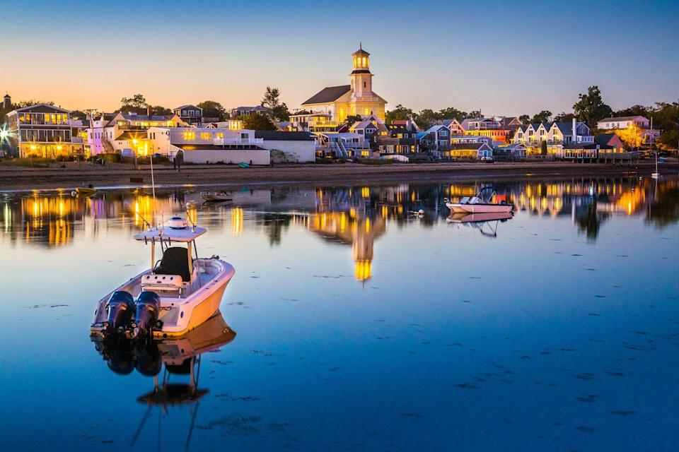 <p>The lights of the village sparkle as another summer evening sets in.</p>
