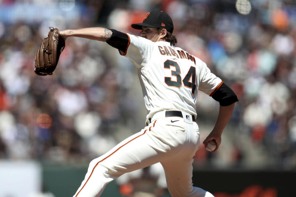 San Francisco Giants' Kevin Gausman throws against the St. Louis Cardinals during the first inning of a baseball game in San Francisco, Monday, July 5, 2021. (AP Photo/Jed Jacobsohn)