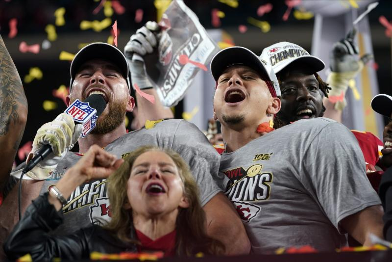 Kansas City Chiefs' Travis Kelce, left, and Patrick Mahomes celebrate after defeating the San Francisco 49ers in the NFL Super Bowl 54 football game Sunday, Feb. 2, 2020, in Miami Gardens, Fla. (AP Photo/David J. Phillip)