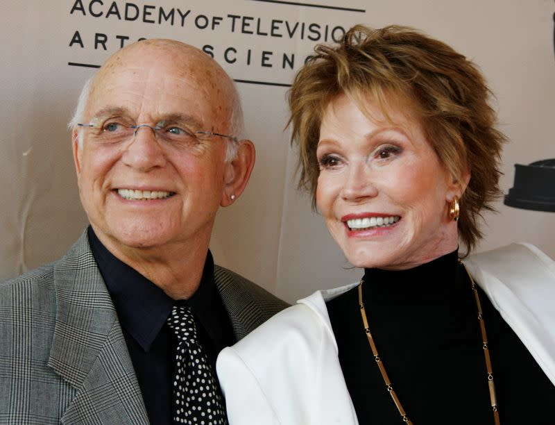 FILE PHOTO: Actress Mary Tyler Moore and actor Gavin MacLeod arrive to honor Betty White in Los Angeles