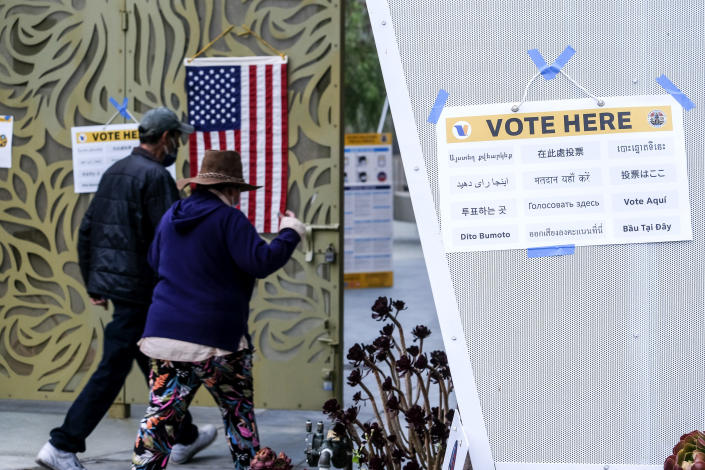 Voters arrive to cast their ballots at the Lincoln Park Senior Center in Los Angeles, Tuesday, Sept. 14, 2021. The recall election that could remove California Democratic Gov. Gavin Newsom is coming to an end. Voting concludes Tuesday in the rare, late-summer election that has emerged as a national battlefront on issues from COVID-19 restrictions to climate change. (AP Photo/Ringo H.W. Chiu)