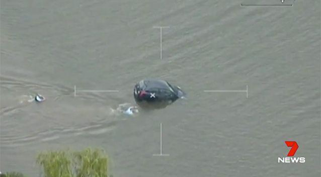 Police officers swam to rescue the woman. Source: 7 News