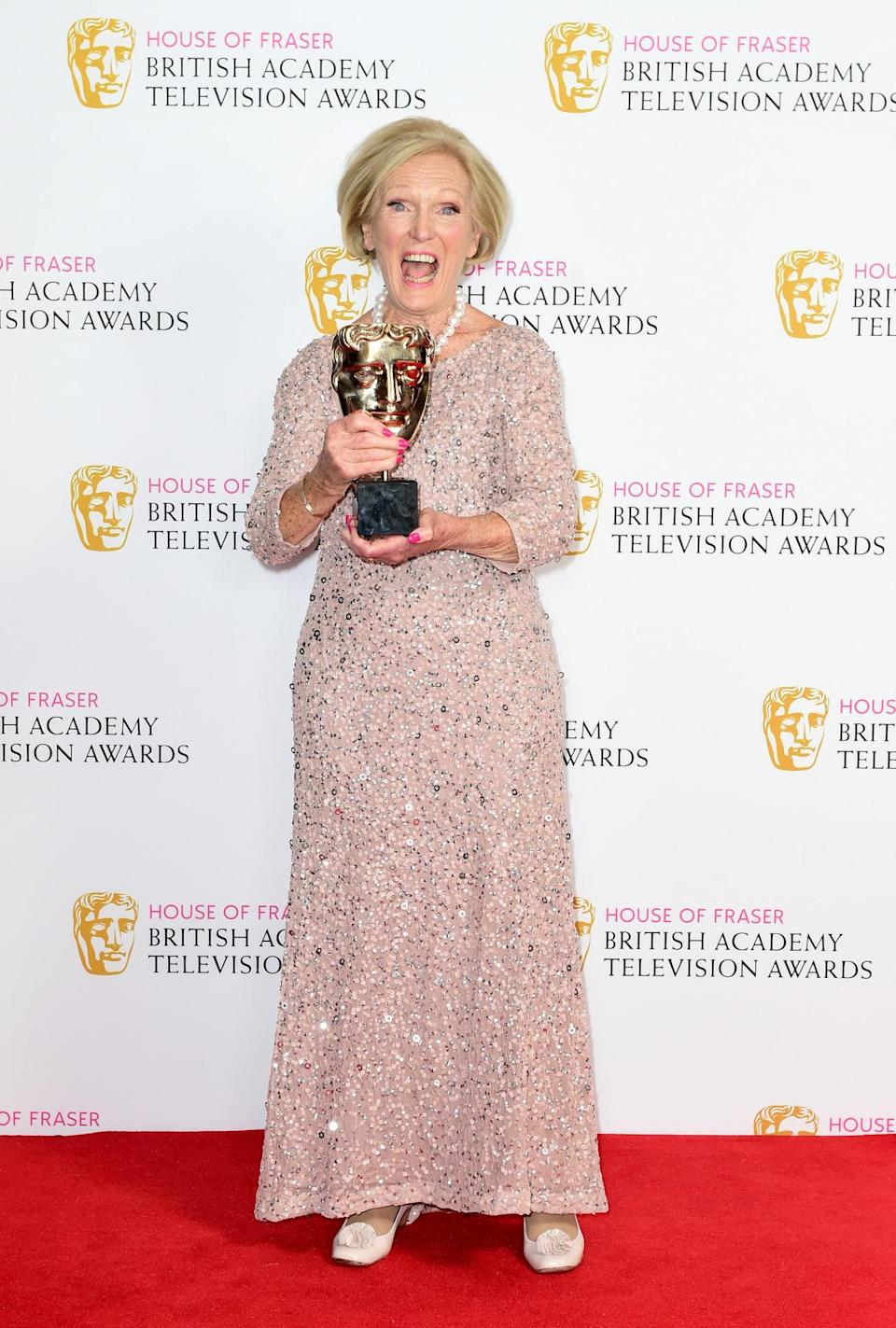 <p>The presenter wore a shimmering Adriana Papell dress to pick up the award for Best Feature at the BAFTA TV Awards. </p><p><i>[Photo: PA]</i><br></p>