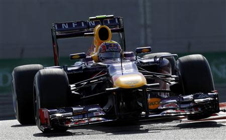 Red Bull Formula One driver Webber of Australia takes a corner during the third practice session of the Abu Dhabi F1 Grand Prix at the Yas Marina circuit on Yas Island