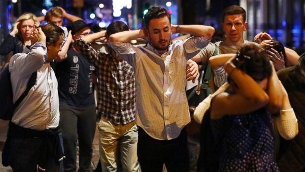PHOTO: People leave the area with their hands up after an incident near London Bridge in London, June 4, 2017. (Neil Hall/Reuters)