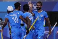 India's Gurjant Singh (9) celebrates after scoring against Japan during a men's field hockey match at the 2020 Summer Olympics, Friday, July 30, 2021, in Tokyo, Japan. (AP Photo/John Locher)