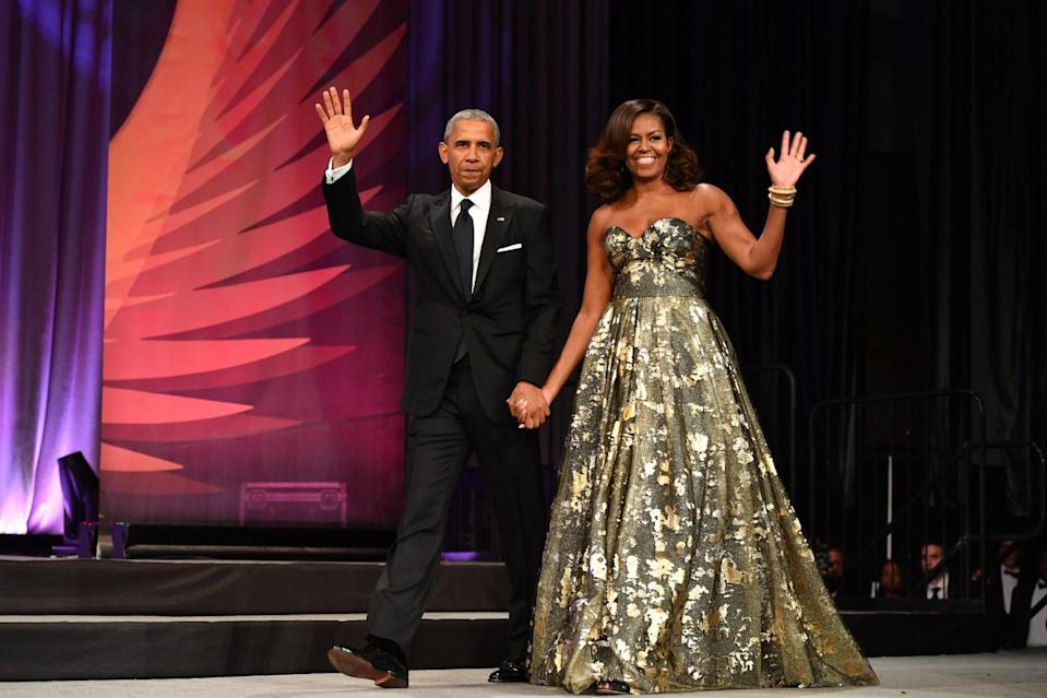 <p>President Barack Obama and First Lady Michelle Obama are making their final rounds at annual Beltway events — and are doing so in serious style. At the Congressional Black Caucus Foundation's 46th Annual Legislative Conference Phoenix Awards Dinner, FLOTUS shined in a strapless gown that appeared to be covered in speckled gold leaf. <i>(Photo: Getty Images)</i></p>