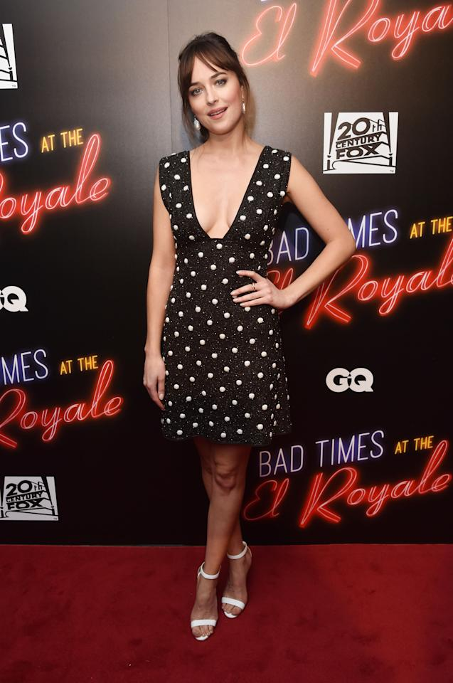 <p>Dakota Johnson looked pretty as a picture wearing a low-cut polka dot dress by hit Danish label Ganni to the premiere of 'Bad Times at the El Royale'.<br />[Photo: Rex] </p>