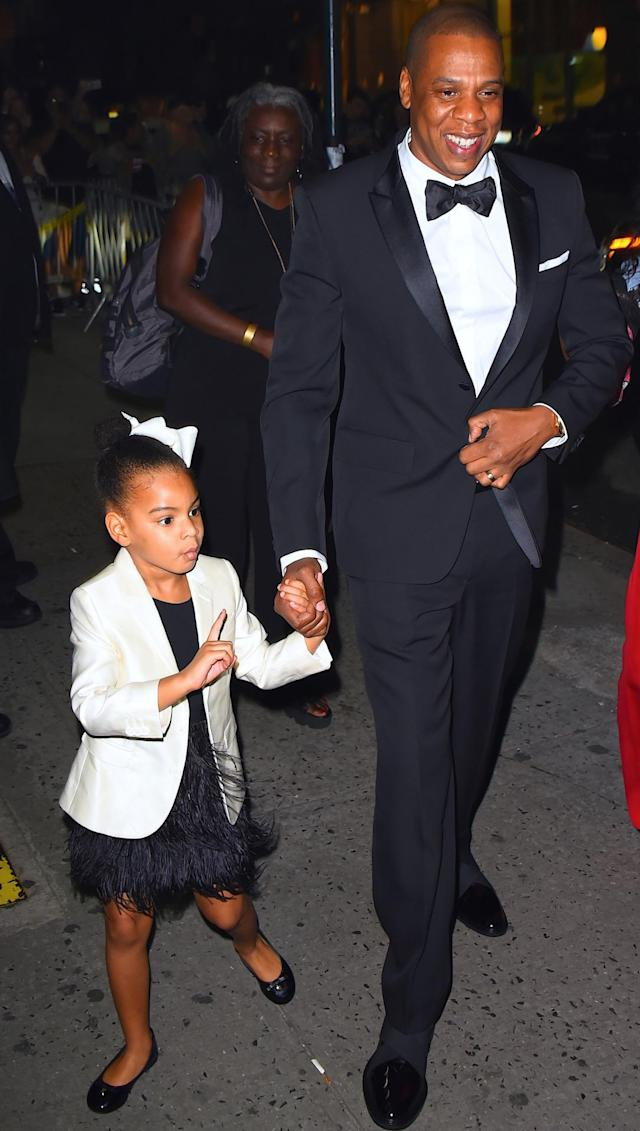 The best part of Blue's appearance there was when the bow-wearing tot arrived with dad. Photographers outside quickly grabbed their cameras, but she appeared to give 'em a good finger wag. Kinda like: No, no, no. I'll tell you how this photo op is gonna go down. (Photo: Robert Kamau/GC Images)