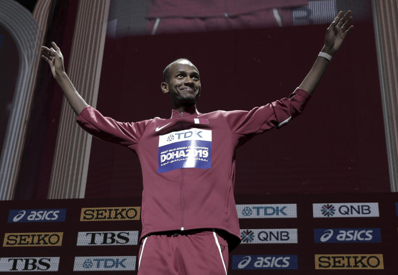 Mutaz Essa Barshim, of Qatar, gold, gestures during the medal ceremony for the men's high jump at the World Athletics Championships in Doha, Qatar, Saturday, Oct. 5, 2019. (AP Photo/Nariman El-Mofty)