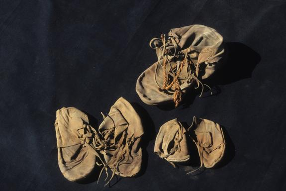 The unwrapped shoe bundle showing the two pairs of children's shoes and the adult isolate.