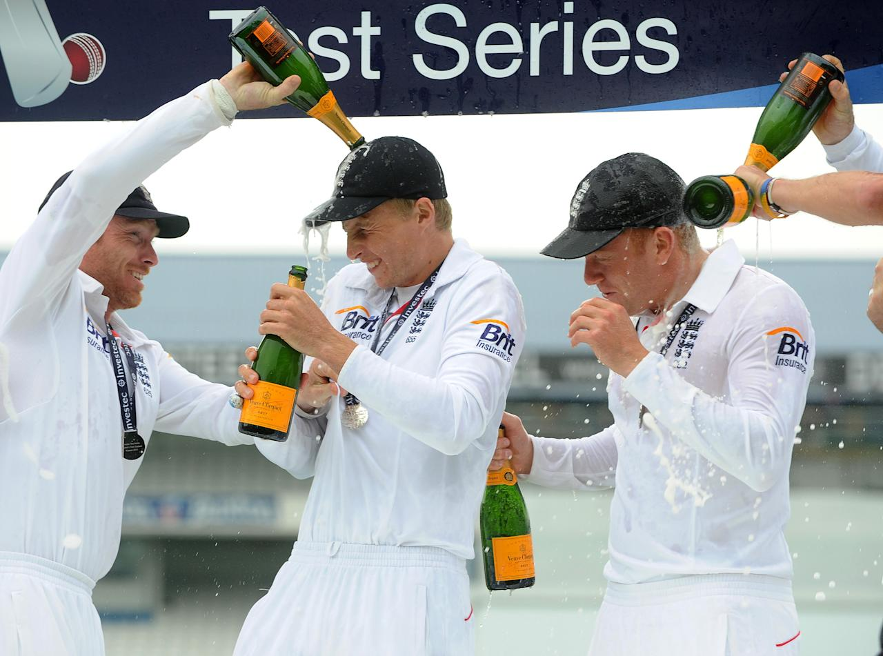 England's Joe Root and Johnny Bairstow gets covered in Champagne while celebrating winning the test series against new Zealand after the Second Investec Test match at Headingley, Leeds.