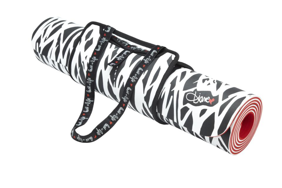 """<b>Diane von Furstenberg for Target + Neiman Marcus Yoga Mat</b><br><br> Price: $49.99<br><br> Celebrated designer Diane von Furstenberg created a black and white yoga mat in a signature twig print. Von Furstenberg is a yoga lover who does yoga on the roof of her house. The designer wanted to incorporate the phrase """"Love is Life"""" into the mat's design, so it is written on the strap of the yoga mat holder. <br><br>"""