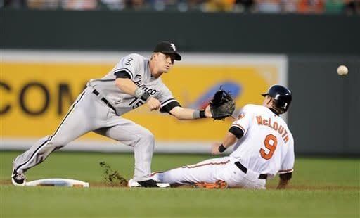 Baltimore Orioles' Nate McLouth (9) steals second as Chicago White Sox second baseman Gordon Beckham (15) awaits the throw during the second inning of a baseball game, Tuesday, Aug. 28, 2012, in Baltimore. McLouth went to third on the throwing error by White Sox catcher A.J. Pierzynski. (AP Photo/Nick Wass)