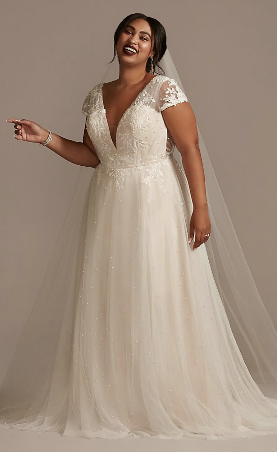 Oleg Cassini Cap Sleeve Low Back Wedding Gown.