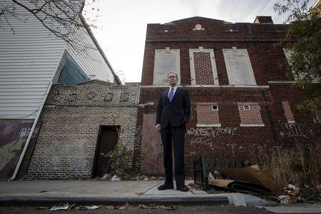 Alexander Sanger, Chair of the International Planned Parenthood Council poses for a photo outside of where his Grandmother Margaret Sanger opened the first birth control clinic 100 years ago, in the Brooklyn borough of New York, December 12, 2015. REUTERS/Carlo Allegri