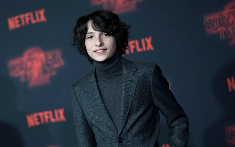 Finn Wolfhard has criticised a model who appeared to flirt with him on social media - AFP