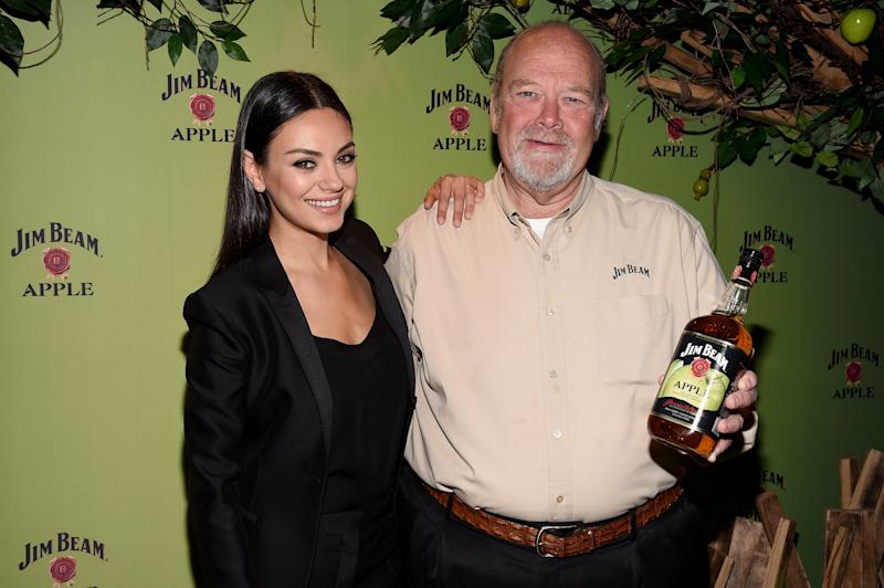 Mila Kunis pictured with Fred Noe, seventh generation Jim Beam Master Distiller, at a Jim Beam Apple launch event on Oct. 20, 2015 in New York City. (Bryan Bedder via Getty Images)