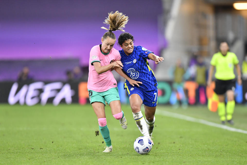 Barcelona's Caroline Graham Hansen, left, fights for the ball with Chelsea's Jessica Carter during the UEFA Women's Champions League final soccer match between Chelsea FC and FC Barcelona in Gothenburg, Sweden, Sunday, May 16, 2021. (AP Photo/Martin Meissner)