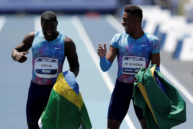 "Justin Gatlin (L) of the U.S. celebrates with Paulo Andre de Oliveira of Brazil after winning the ""Mano a Mano"" challenge, a 100-meter race, at the Brazilian Jockey Club in Rio de Janeiro, Brazil October 1, 2017. REUTERS/Bruno Kelly"